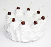 White cake with cherry. Festive  cake isolated on white background Royalty Free Stock Image
