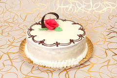 White cake with chocolate ornaments Stock Photos