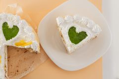 White cake on a colored background with ribbons shot from above stock photos