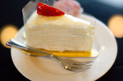 White Cake. Dessert with whipped cream and strawberries Royalty Free Stock Photo
