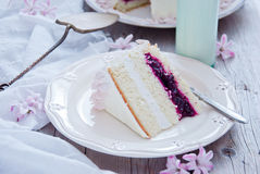 White cake with pink flowers. Homemade white cake with pink flowers and a bottle of milk Stock Photos