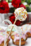 White cake pops. Colorful muffins in the background Royalty Free Stock Image