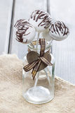 White cake pops decorated with dark chocolate Royalty Free Stock Photo