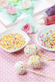 White cake pops on pink dotted table cloth Stock Image