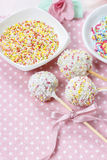 White cake pops on pink dotted table cloth Royalty Free Stock Image