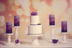 White cake with purple candles Royalty Free Stock Photos