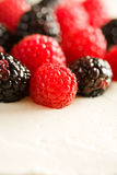 White Cake with Raspberries and Blackberries Stock Photography