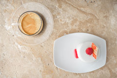White cake with raspberry and coffee on the stone table Stock Photography