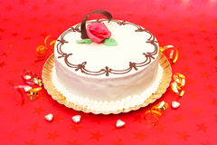 White cake on red background Royalty Free Stock Photo