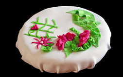 White cake with roses and leaves made of marzipan Royalty Free Stock Images