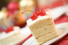 White cake topped with cherries Stock Image