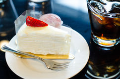 White Cake and Water. Dessert with whipped cream and strawberries and water Stock Photos