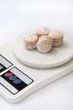 White cakes with powdered sugar on a kitchen scale Royalty Free Stock Images