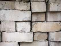 White calcium silicate bricks piled on top of each other. Old, cracked and chipped brick built, rough stack. The texture Stock Photography