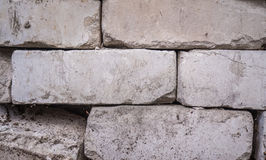 White calcium silicate bricks piled on top of each other. Old, cracked and chipped brick built, rough stack. The texture Royalty Free Stock Photos