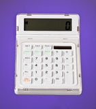 White Calculator on Purple. A White Calculator on a Purple background royalty free stock images