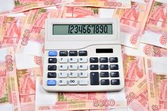 White calculator is on the Russian banknotes five thousand ruble Royalty Free Stock Photo
