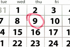 White calendar page with date circled in red stock photography