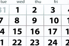 White calendar page with dates top view royalty free stock photography