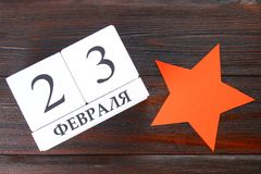 White calendar with Russian text: February 23. Holiday is the day of the defender of the fatherland. White calendar with Russian text: February 23. Holiday is Stock Photo