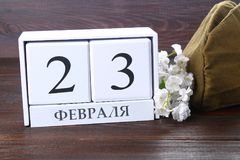 White calendar with Russian text: February 23. Holiday is the day of the defender of the fatherland. White calendar with Russian text: February 23. Holiday is Royalty Free Stock Photos