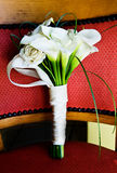 White calla lily wedding bouquet. On a chair Royalty Free Stock Photography