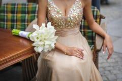 White calla wedding bouquet on table Stock Photos