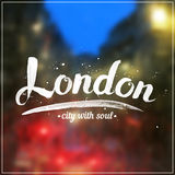 White calligraphy London sign on blurred photo Stock Images