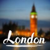 White calligraphy London sign on blurred photo Stock Image