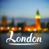 White calligraphy London sign on blurred photo Royalty Free Stock Photo