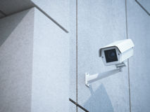 White camera on the concrete office wall royalty free stock photography