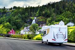 White camper near Steinsdalsfossen waterfall. White camper near one of the most popular waterfalls in Norway - Steinsdalsfossen, on the Fosselva river in western royalty free stock photography