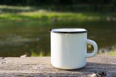 White campfire enamel mug mockup with sun beams royalty free stock photo
