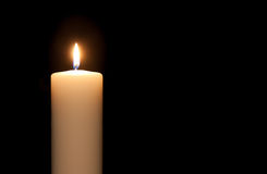 White candle. Isolated against a black background Stock Photo
