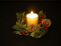 White Candle. Lit White Christmas Candle royalty free stock photography