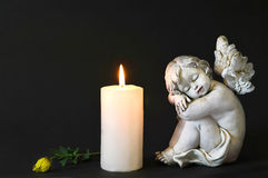 White candle, an angel and flower Royalty Free Stock Photo