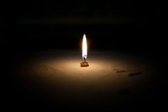 White candle on a black background Stock Photos