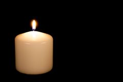 White candle on black background with copy space Royalty Free Stock Images