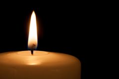 White candle on black background with copy space Stock Images