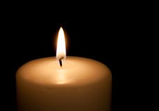 White candle on black background with copy space Royalty Free Stock Photos