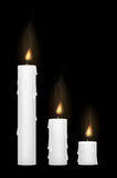 White candle on a black blackground. A white candle on a black blackground Stock Photography