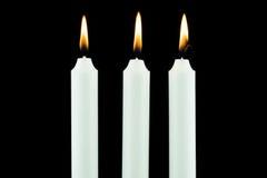 White Candle On Black Stock Photos