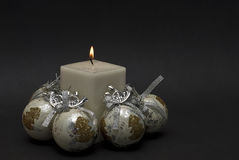 White candle and bright ballls. Royalty Free Stock Photos