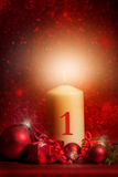 White candle / candle with Christmas decoration against red back Stock Images