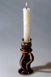 White candle. In a ceramic candlestick Royalty Free Stock Photography