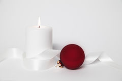 White candle and christmas ball Royalty Free Stock Photo