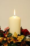 White candle with Christmas decorations. Royalty Free Stock Images