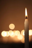 White candle on dark background Stock Image