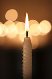 White candle on dark background Royalty Free Stock Photos