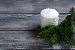 White candle and fir branches on the boards Royalty Free Stock Images